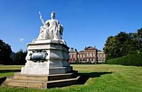 Statue of Queen Victoria by her daughter Princess Louise, outside Kensington Palace, London, UK