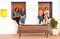 Girls posing in bench, Popular festivities in Carricola, Valencia