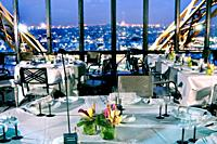 Paris, France, Haute-Cuisine French Cuisine Restaurant in Eiffel Tower, Jules Verne, Dining Room with Overview at Dusk