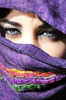 Attractive young woman with clear blue eyes with her face covered