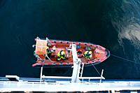 A life boat is launched to rescue a man over board