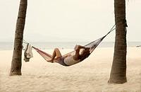 people resting on a hammock  Cua Dai beach  Hoi An, Vietnam, Asia