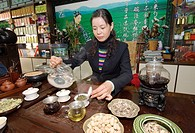 Tea merchant Lin Guang Xia serving fine Chinese green tea in headquarters of her tea shop chain  Zibo, Shandong Province, China