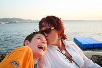 Mother and son at sunset, Ibiza, Balearic Islands, Spain