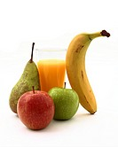 A glass of orange juice with a banana, red and green apples and a pear on a white background.