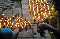 Early morning during Indra Jatra festival, there were many women praying at Maru Tole in Durbar Square, Kathmandu Nepal
