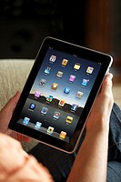 Close up of a woman handholding an iPad