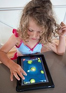 Child playing computer game on an iPad tablet computer