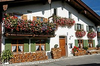 Germany Bavaria Garmisch-Partenkirchen Fruhling Strasse decorated bavarian buildings with balconies and flowers architecture
