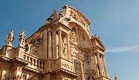 Main facade of the Cathedral Church of Saint Mary in Murcia, at the plaza del Cardinal Belluga, City of Murcia, Southeastern Spain