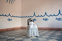 Photograph of a black doll with white dress representing the Santeria Yemaya in the interiors of the Casa Templo de Santeria Yemaya the temple of the ...