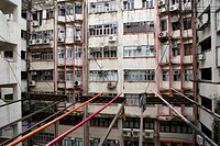 CHINA HONG KONG KOWLOON TSIM SHA TSUI NATHAN ROAD Postwar apartments in bad condition with noticeable the colored sticks that Chinese are using for dr...