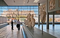 The Parthenon and Acropolis seen through the windows of the new Acropolis Museum, designed by architect Bernard Tschumi, Athens, Greece