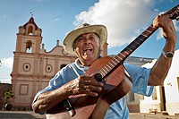 Man with Spanish guitar singing in ´Plaza del Carmen´ , Camaguey, Cuba, Caribbean