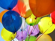 A bunch of colorful birthday balloons