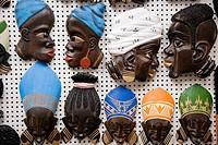 Wooden Sculptures of Black Faces for sale inside The Mercado Modelo Market, Salvador, Bahia, Brazil
