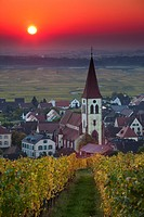 France, Haut-Rhin, Alsace Region, Alasatian Wine Route, Ammerschwihr, town view, sunrise, autumn
