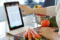 Woman browsing cooking instruction online with Epicurious iPad cooking app