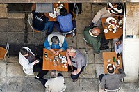 Men relaxing at taverna in a side street near Omonia Square, central Athens, Greece