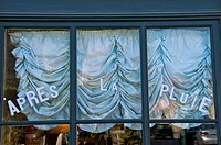 Window shop with draped curtains and enamel letters Beaumont en Auge Calvados 14 Normandy France