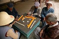 Grandparents playing mahjong, Shaxi, Jianchuan County, Yunnan, China