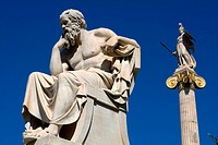 Statue of philosopher Socrates and behind him Athena statue goddess of wisdom, warfare and crafts outside of Athens Academy in the center