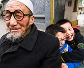 A Hui Muslim man with his two grandchildren