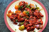 Nepal food , Chicken chilli or indian chilli chicken nepalese style in a sticky pepper sweet and chilli marinate