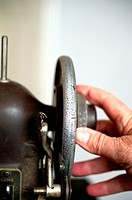 Hand Turning Wheel on Antique Sewing Machine