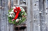 Snowy Christmas Wreath on Side of Barn