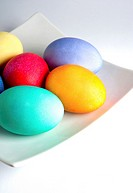 Colored Easter Eggs on a White Plate