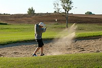 golf player trying a shot