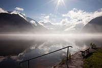 Hallstatt, Salzkammergut, Austria, Europe  View across Hallstattersee Lake with morning mist rising in the Austrian Alps