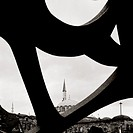 Islamic minaret contrasts with modern art in Istanbul in Turkey in Middle East.