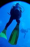 Two scuba divers swimming around Cathedral Dive Spot, Pango Point, Efate Island, Vanuatu