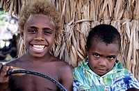 Portrait of two boys standing side by side, Sulphur Bay Village, Ipekel Ipeukel, Tanna Island, Vanuatu