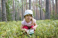 Three Year Old Berry-Picker Girl in Forest