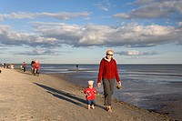 Woman with Kid in Red Clothes Walking Hand in Hand on Pärnu Beach in Estonia, Europe
