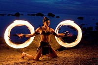 Semi Nude Woman Fire Dancer in Costume Juggling Torches by Water