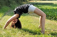 Young woman doing a cartwheel