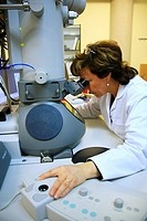 Working with an electron microscope in a laboratory.