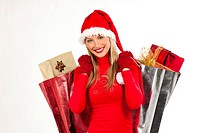 Rich, colorful series of attractive young woman in santa´s hat with presents