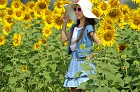 girl with hat , sunflower fields of lopburi , central Thailand