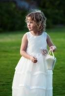 A flower girl for an outdoor wedding on Oahu, Hawaii, USA.