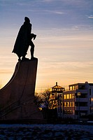Statue of Leifur Eiriksson Leif Ericson at sunset  Hallgrimskirkja church, downtown Reykjavik, Iceland  He was a Norse explorer who was probably the f...