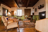 Living room with antique furnishings in an Old circa 1850 Canadiana Cottage style fieldstone residential home, Quebec, Canada  This image is property ...