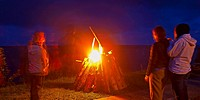 People standing around bonfire, Estonia