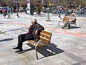 Elderly men sitting in plaza Granada spain