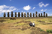 Couple sitting at Ahu Tongariki Moai - Easter Island, Chile