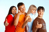 Four young people on white background laughing and giving the thumbs-up sign